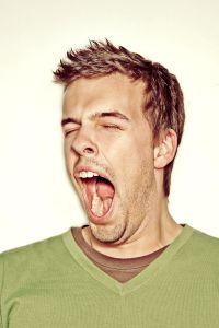 Man yawning Charlotte Injury Lawyer North Carolina Medical Malpractice Attorney.jpg