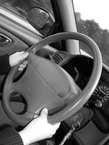 Holding Steering wheel Charlotte Injury Lawyer Mecklenburg Car Accident Attorney