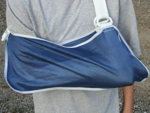 Arm-in-sling-Charlotte-Mooresville-Injury-Lawyer-300x226