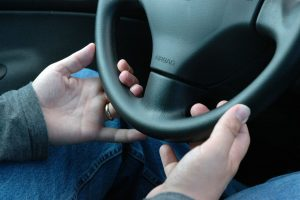 Hands-on-steering-wheel-Charlotte-Lake-Norman-Injury-Lawyer-300x200