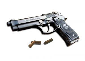 handgun-and-bullets-Charlotte-Criminal-Lawyer-Mooresville-DWI-Attorney-300x216