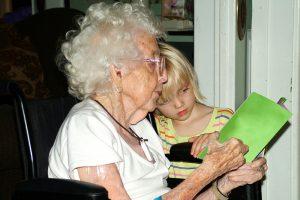 reading-with-grandmother-Charlotte-Monroe-Mooresville-Nursing-home-Coronavirus-injury-lawyer-300x200