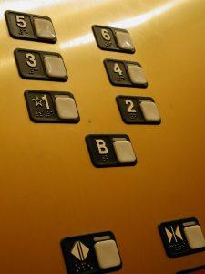 elevator-buttons-Charlotte-Monroe-Mooresville-premises-liability-attorney-225x300