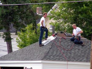men-on-roof-workers-compensation-Attorneys-Charlotte-Monroe-Mooresville-300x225